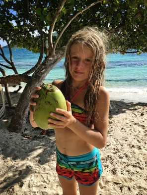 Amelie with a 'Water Nut' or young coconut